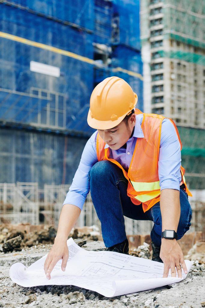 Civil engineer examining floor plan